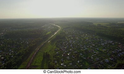 Aerial scene with countryside and moving train, Russia -...