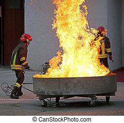brave firefighters during the test of a fire extinguishing...