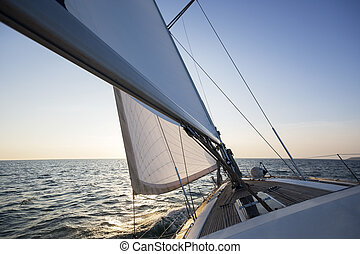 Luxury Boat Sailing In Sea During Sunset - Luxury boat...
