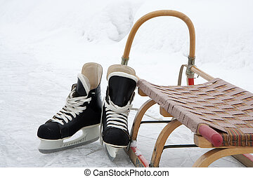 Skates and sledge on the ice