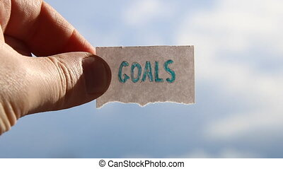 goals idea, tag with inscription, blurred photo for...