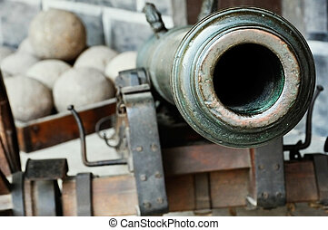 Cannon - A cannon. The cannon is directed to the camera....