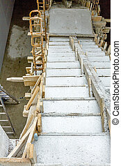 Unfinished staircase made of concrete in new building -...
