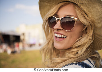 Cheerful blonde spending time outdoors