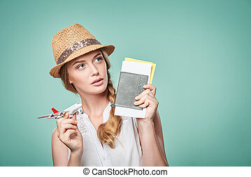 Woman in straw hat holding airplane model in hand - Closeup...