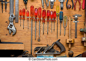 screwdrivers - set of screwdrivers and other tools hanging...