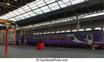 Blue purple train is leaving station - Passenger information...