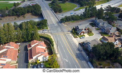 Aerial view of residential houses and road interchange -...