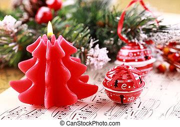 Christmas carol - Christmas still life with candles, jingle...