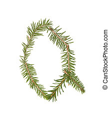 Spruce twigs forming the letter 'Q'