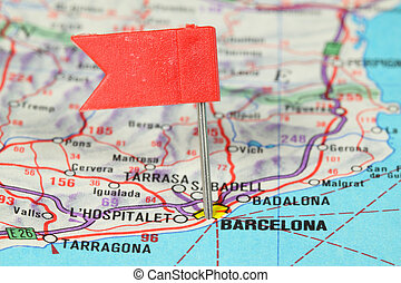 Barcelona - famous city in Spain. Red flag pin on an old map...