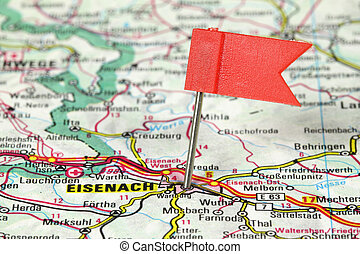 Eisenach - famous city in Germany. Red flag pin on an old...