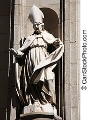 Bishop statue in the facade of Toledo Cathedral, Spain