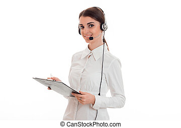 young girl in white shirt and headphones with microphone...