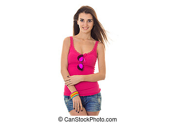 beautiful young girl in a bright pink t-shirt looks into the camera and smiling