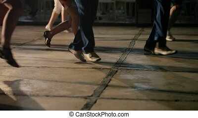 People dancing synchronous at night