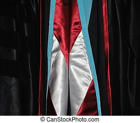 Graduation gown. - Graduation gown displayed outdoors.