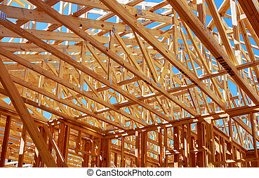 Wood framing on new house under construction - Wood framing...