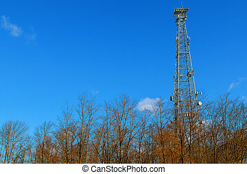 image of communication mobile internet antenna over blue sky background