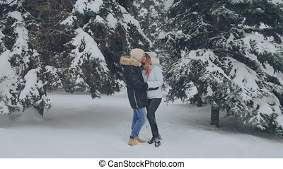 loving couple kissing in winter park
