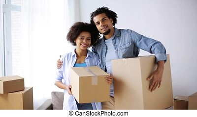 happy couple with boxes moving to new home - people, repair...