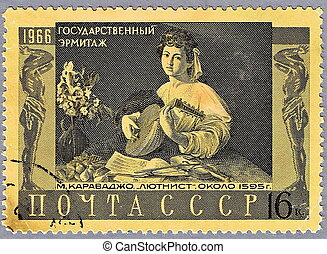 The Lute Player by Caravaggio - USSR - CIRCA 1966: A stamp...