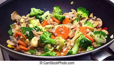 fried vegetarian food cooked in a wok