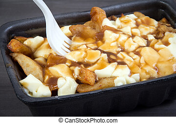 Poutine quebec meal with french fries, gravy and cheese...
