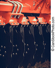 Detailed closeup of disc harrow agricultural machinery -...