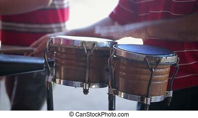 Man playing percussion at sunny day
