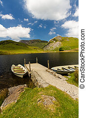 Llyn y Dywarchen Reservoir with two rowing boats by jetty,...