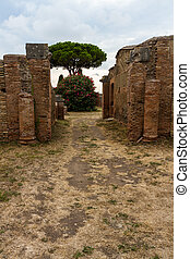 Roman path and buildings at Ostia Antica Italy with Stone...