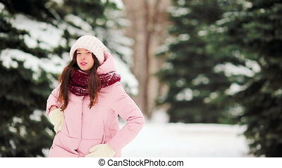 Happy woman at snow weather outdoors on beautiful cold day -...