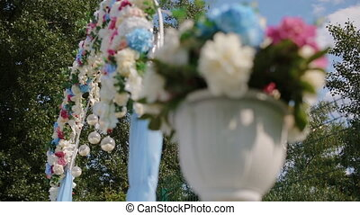 Wedding decoration. Arch with natural flowers