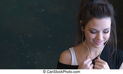 A beautiful young girl dancing to the music. Use headphones...