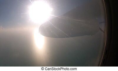 Airplane flying at sunny day - Propeller airplane flying at...
