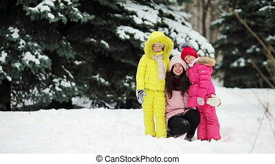 Happy family enjoy winter snowy day - Happy family playing...