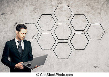 Businessman using notebook - Handsome young businessman...