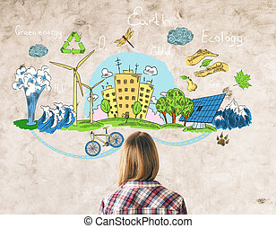Go green concept - Back view of young girl looking at eco...