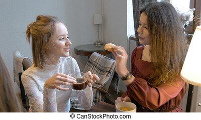 Young beautiful girl drinking tea and coffee, fun,...