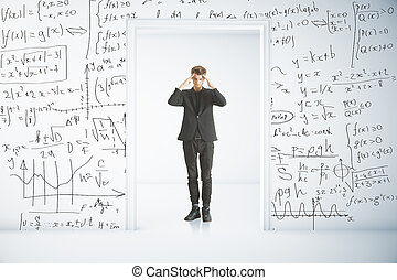 Education concept - Pensive young businessman standing in...