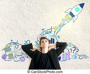 Entrepreneurship concept - Relaxing young man on textured...