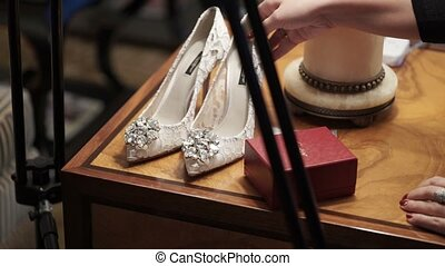 Preparing woman's shoes for shooting photo and video