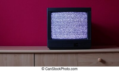 TV no signal - No signal just noise on an old TV in a dim...