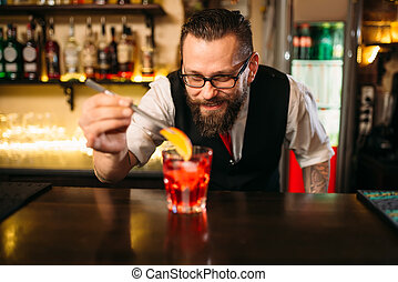 Bartender making alcohol coctail in restaurant - Bartender...