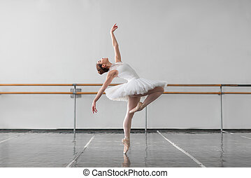 Female ballet dancer keep the rack in class - Beautiful...