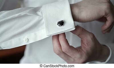 Young man wearing cufflinks closeup