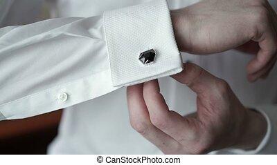 Young man wearing cufflinks closeup