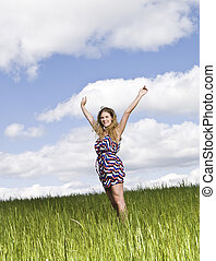 Young woman standing on a field