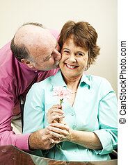 Flower for His Lady - Handsome older man gives a flower to...